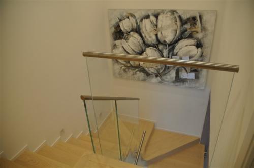 G114-Parapetto in vetro con vetro sagomato